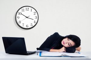 Woman asleep at her desk, Accurate Acupuncture Chronic Fatigue Syndrome