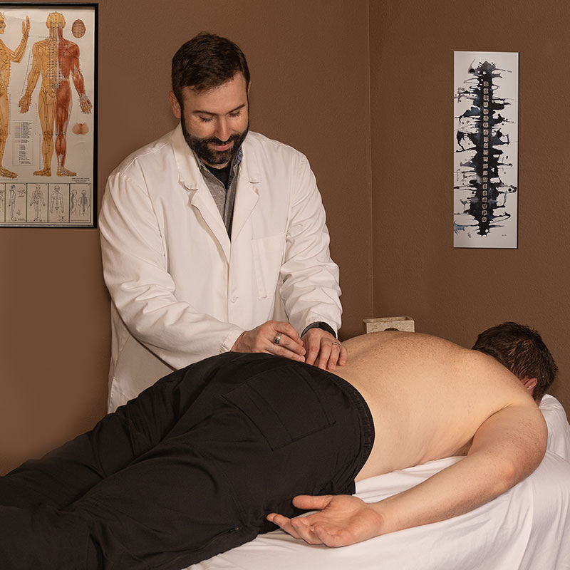 David LeGar treating lower back pain with acupuncture covered by insurancde