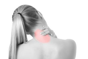 woman holding her neck due to pain